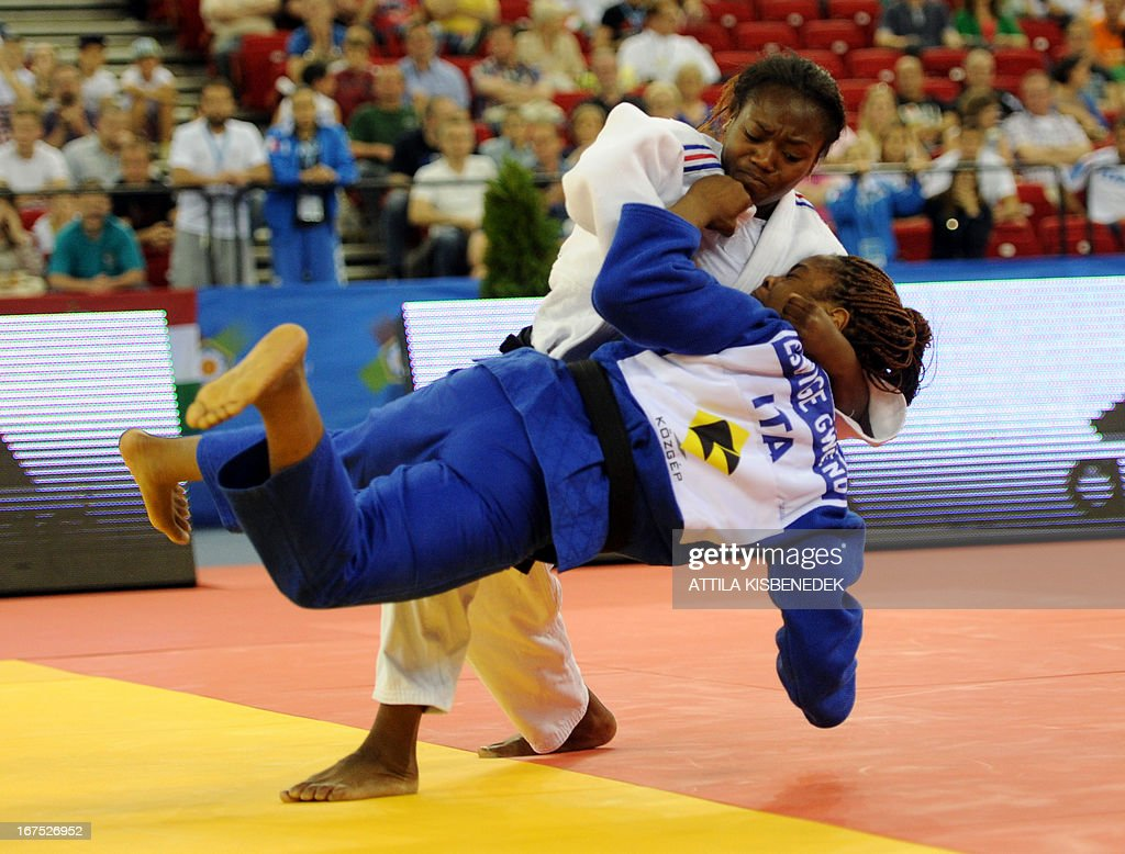 France's Clarisse Agbegnenou (white) figths with Italy's Edwige Gwend (blue) during the Judo European Championships in 63kg category for women in Budapest on April 26, 2013. AFP PHOTO / ATTILA KISBENEDEK