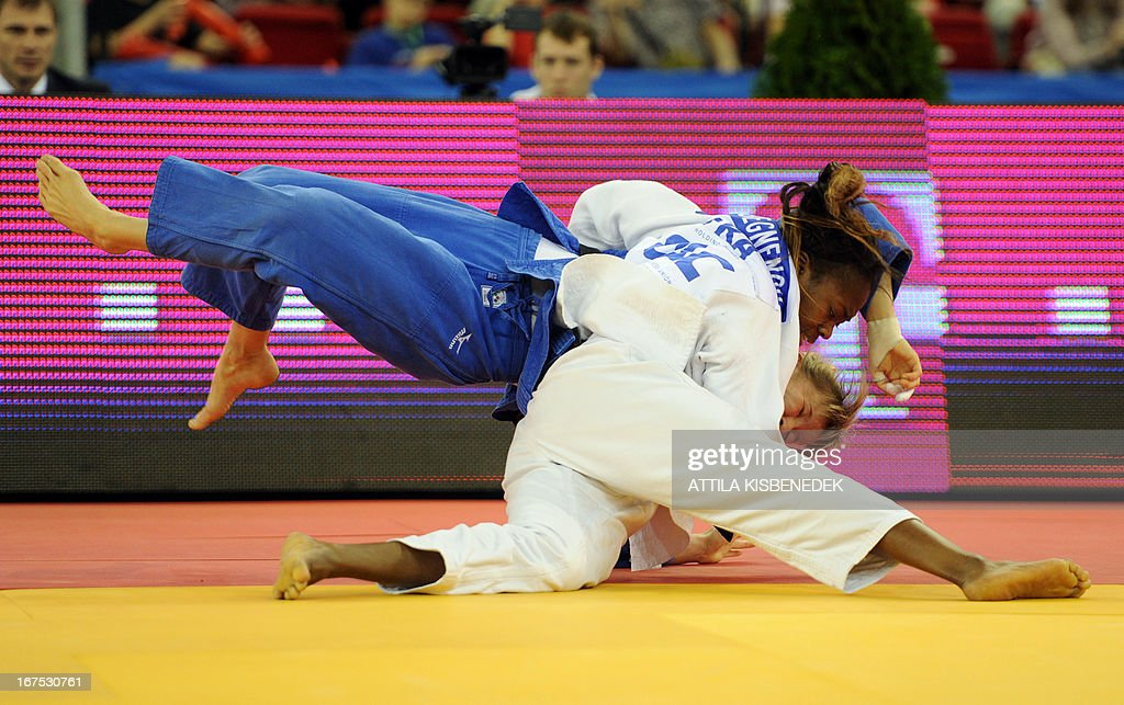 France's Clarisse Agbegnenou (white) figths with Russia's Marta Labazina (blue) during their fighting of the Judo European Championships in final of the 63kg category for women in Budapest on April 26, 2013. Agbegnenou won the gold medal.