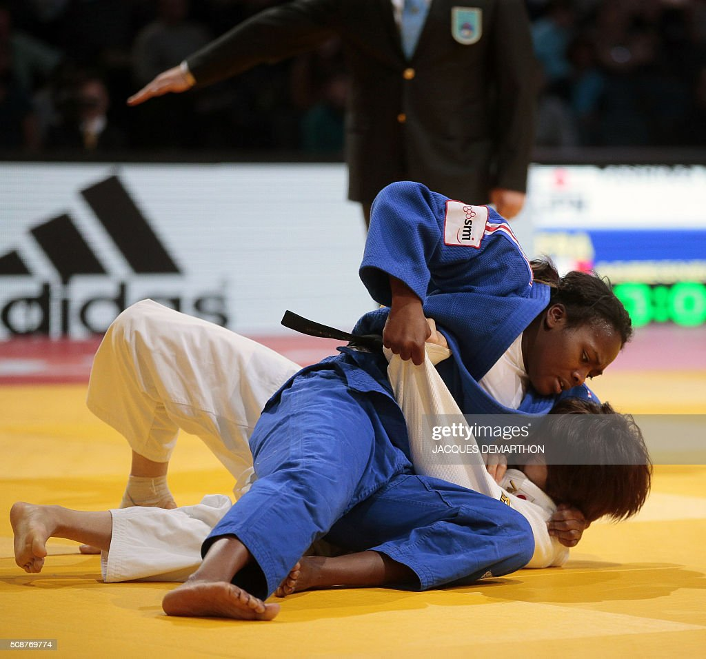 France's Clarisse Agbegnenou (L) immobilises Japan's Miku Tashiro and wins the women's under 63 kg final of the Paris Grand Slam Judo tournament on February 6, 2016 in Paris. / AFP / JACQUES DEMARTHON
