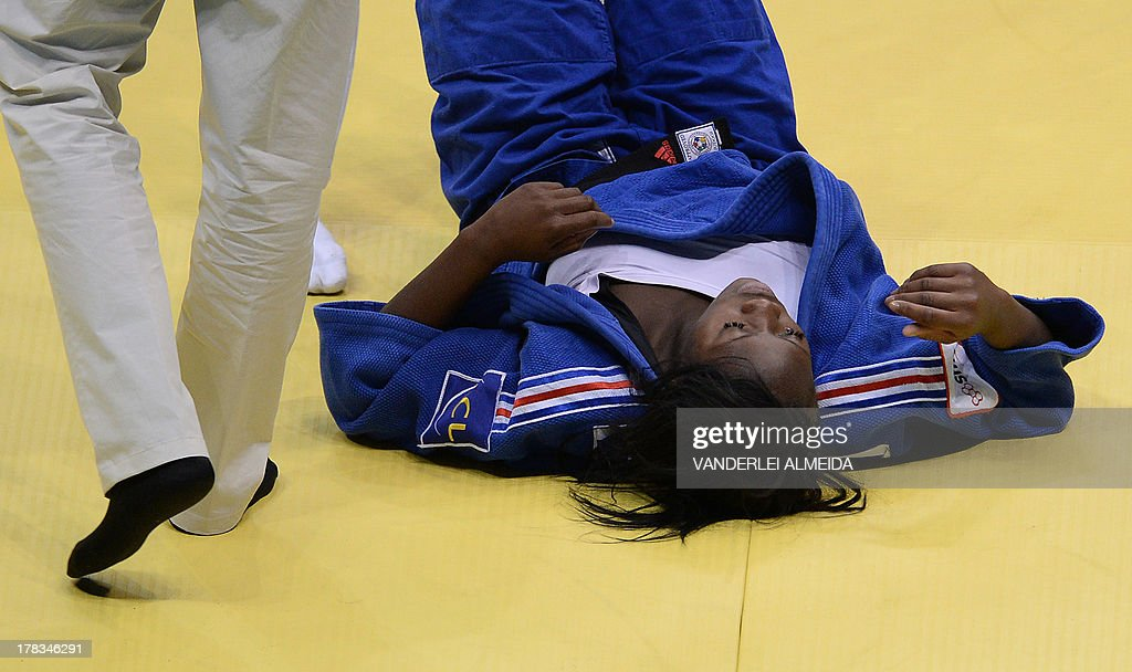 France's Clarisse Agbegnenou(blue) lies on the floor after the fight against Israel's Yarden Gerbi after the women's 63kg category final of the IJF World Judo Championship in Rio de Janeiro, Brazil, on August 29, 2013.