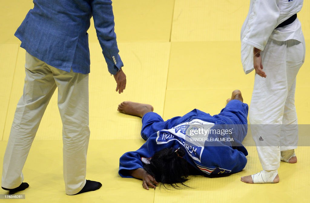 France's Clarisse Agbegnenou(blue) lies on the floor next to her competitor Israel's Yarden Gerbi after the women's 63kg category final of the IJF World Judo Championship in Rio de Janeiro, Brazil, on August 29, 2013.