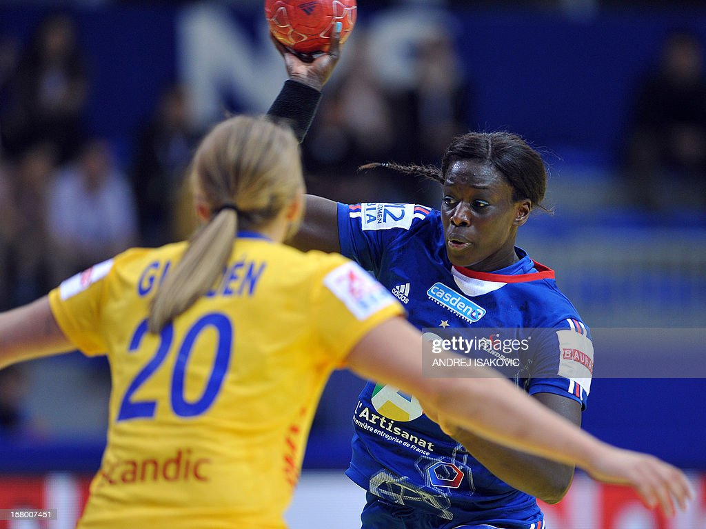 France's Claudine Mendy (R) vies with Sweden's Isabelle Gullden (L) during their Women's EHF Euro 2012 Handball Championship match Sweden vs France on December 8, 2012, at the Hall Cair in Nis.