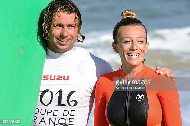 France's Clement Cetran and Dhelia Birou Cetran pose aftering competing in the International Tandem Surfing Championship on July 23 2016 in...