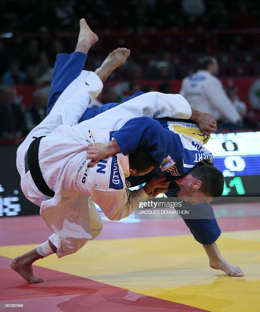 France's Clement Delvert (blue) fights against Tunisia's Anis Ben Khaled (white) on February 10, 2013 in Paris, during the eliminatories of the Men - 100kg of the Paris Judo Grand Slam tournament. AFP PHOTO