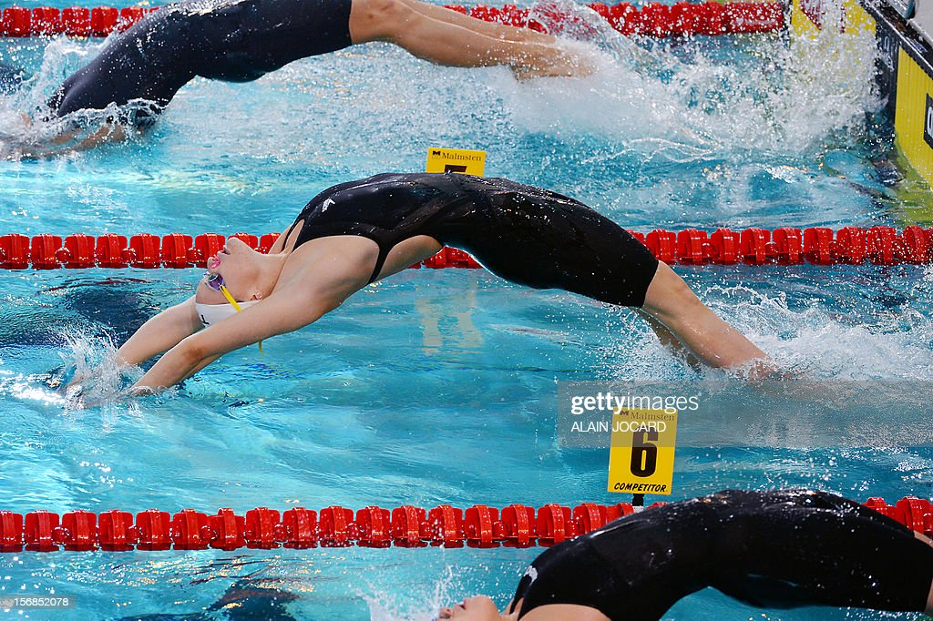 France's Cloe Credeville dives at the start of the 4X50 mixed medley at the European Short Course Swimming Championships on November 23, 2012, in Chartres. JOCARD