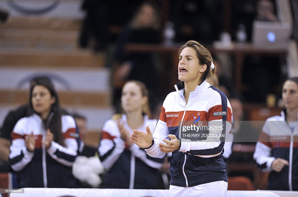 France's coach Amelie Mauresmo cheers Pauline Parmentier during her Fed Cup 2013 tennis match against Germany's Julia Goerges on February 10, 2013 at the Beaublanc courts in Limoges. Germany completed a 3-0 win over France in a Fed Cup World Group II tie today when Julia Goerges defeated Pauline Parmentier 6-4, 6-2.