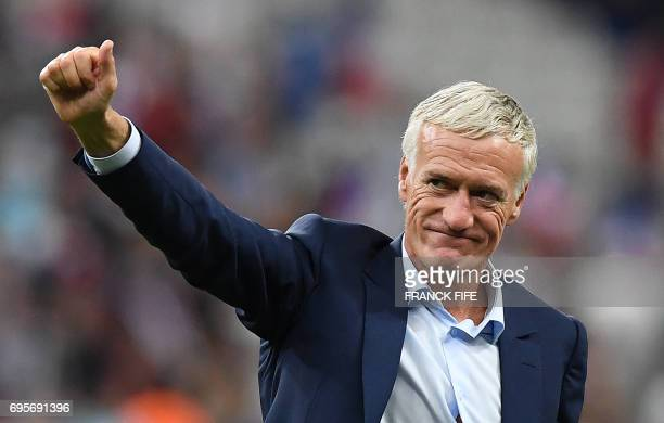 France's coach Didier Deschamps acknowledges the crowds following his team's 32 win over England during the international friendly football match...