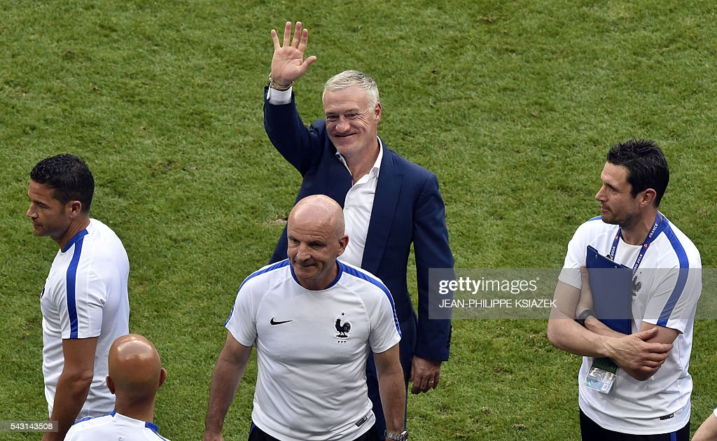 France's coach Didier Deschamps celebrates his team's win after the Euro 2016 round of 16 football match between France and Republic of Ireland at the Parc Olympique Lyonnais stadium in Décines-Charpieu, near Lyon, on June 26, 2016. France won the match 2-1. / AFP / JEAN