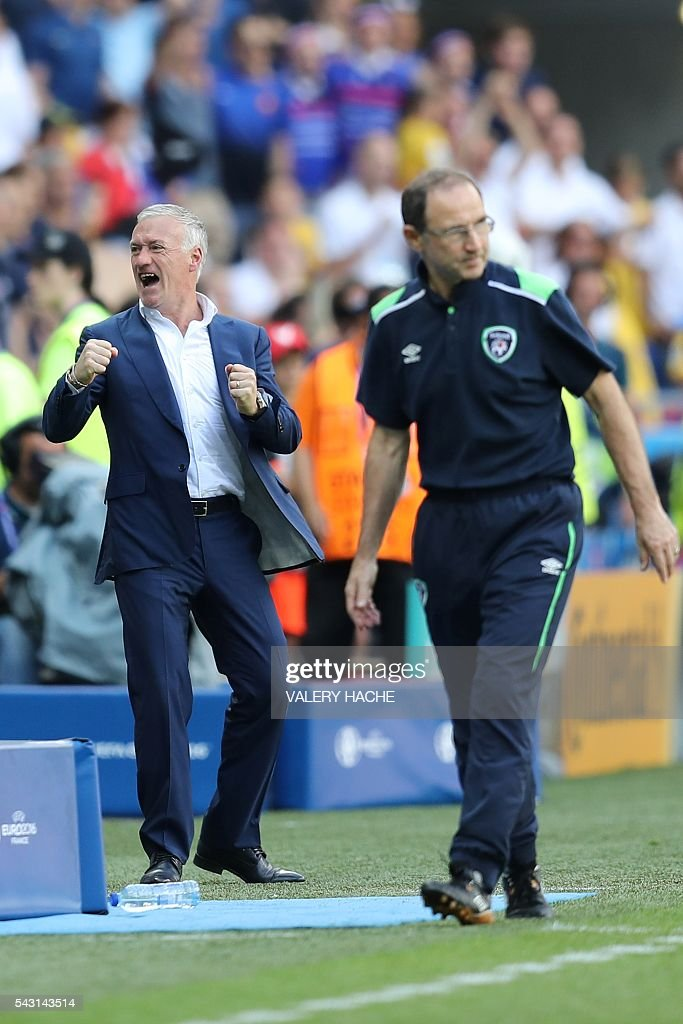 France's coach Didier Deschamps (L) celebrates his team's win next to Ireland's coach Martin O'Neill after the Euro 2016 round of 16 football match between France and Republic of Ireland at the Parc Olympique Lyonnais stadium in Décines-Charpieu, near Lyon, on June 26, 2016. France won the match 2-1. / AFP / Valery HACHE