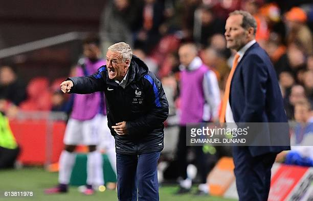 France's coach Didier Deschamps gestures next to Dutch coach Danny Blind during the FIFA World Cup 2018 qualifying football match Netherlands vs...