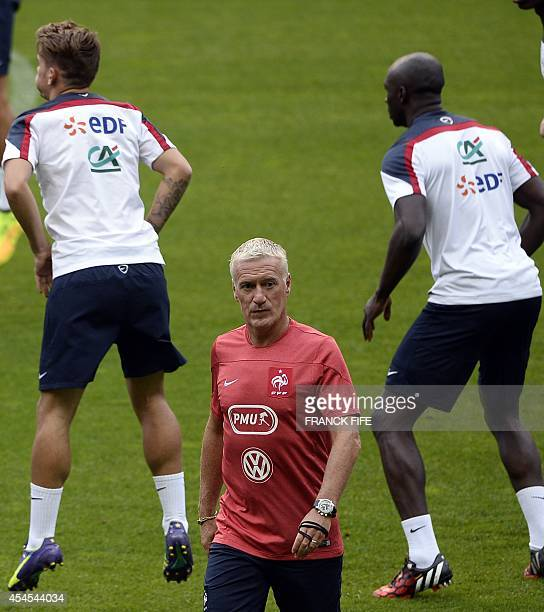 France's coach Didier Deschamps leads his team's training session on September 3 on the eve of the team's friendly football match against Spain at...