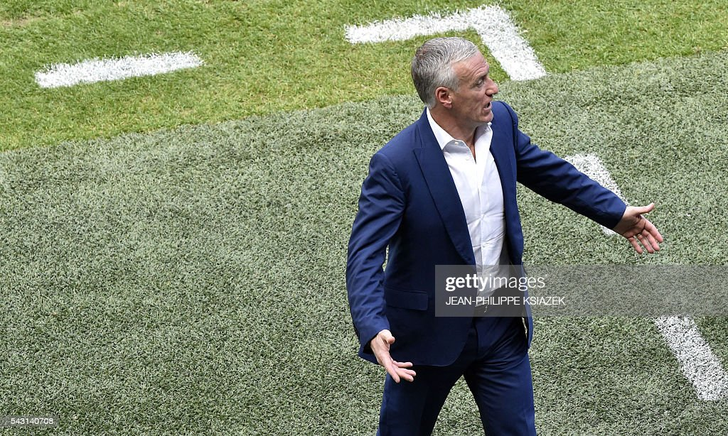 France's coach Didier Deschamps reacts during the Euro 2016 round of 16 football match between France and Republic of Ireland at the Parc Olympique Lyonnais stadium in Décines-Charpieu, near Lyon, on June 26, 2016. / AFP / JEAN