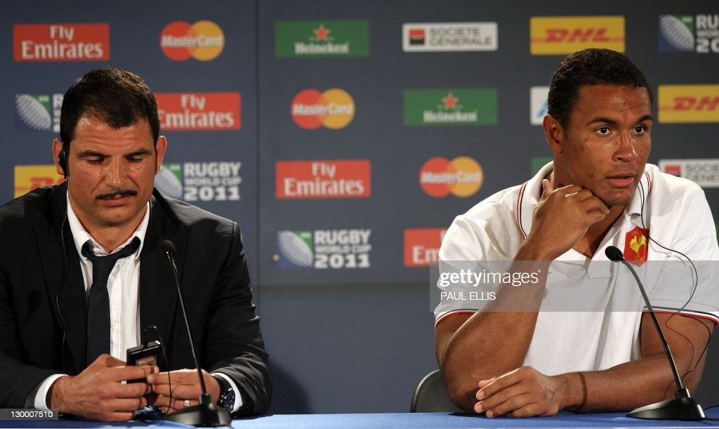 France's coach Marc Lievremont (L) and captain Thierry Dusautoir react during a press conference after the 2011 Rugby World Cup final match New Zealand vs France at Eden Park Stadium in Auckland on October 23, 2011.