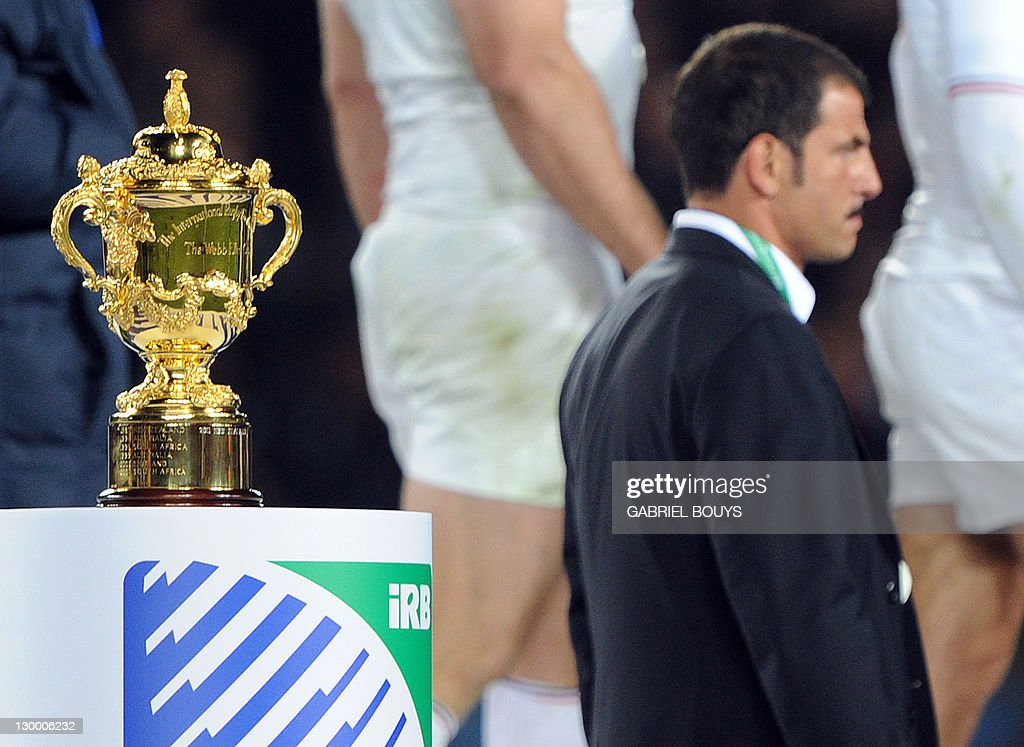 France's coach Marc Lievremont walks in front of the Webb Ellis cup after the 2011 Rugby World Cup final match New Zealand vs France at Eden Park Stadium in Auckland on October 23, 2011.