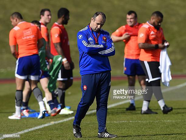 France's coach Philippe SaintAndre attends a training session in Marcoussis south of Paris on March 17 2015 ahead of the Six Nations rugby union...