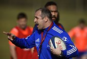 France's coach Philippe SaintAndre speaks to players during a training session in Marcoussis south of Paris on March 17 2015 ahead of the Six Nations...