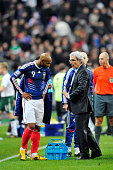 France's coach Raymond Domenech and Nicolas Anelka during World Cup Playoff soccer match France vs Republic of Ireland at Stade de France in...