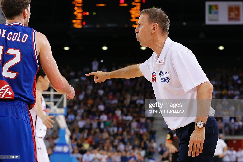 France's coach Vincent Collet gestures during the friendly basketball match between France and Japan at the Kindarena hall in Rouen on June 28, 2016. / AFP / CHARLY