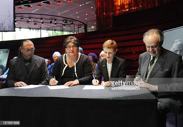 France's Culture minister Frederic Mitterrand attends a signature ceremony flanked by New Zealand's Te Papa museum rapatriation councellor Derek...