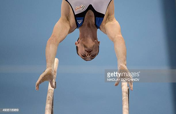 France's Cyril Tommasone competes on the parallel bars in the men's team artistic gymnastics final during the 31st European Men's Artistic Gymnastics...