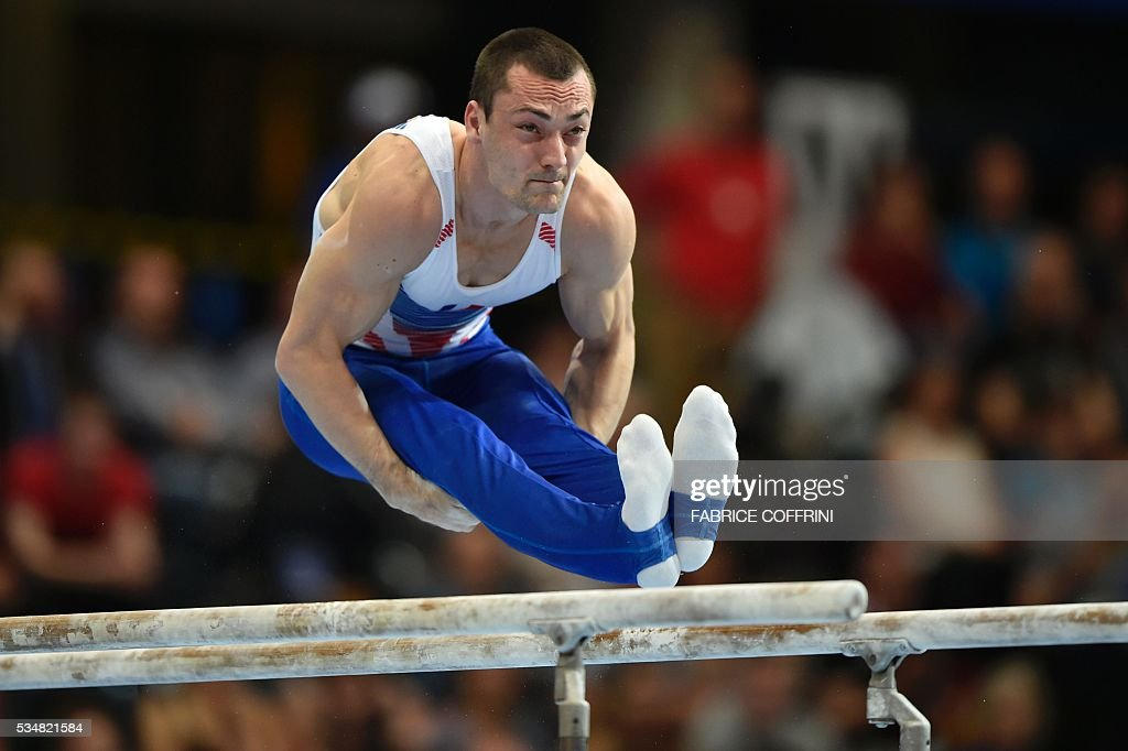 France's Cyril Tommasone performs during the Mens Parallel Bars competition of the European Artistic Gymnastics Championships 2016 in Bern, Switzerland on May 28, 2016. / AFP / FABRICE