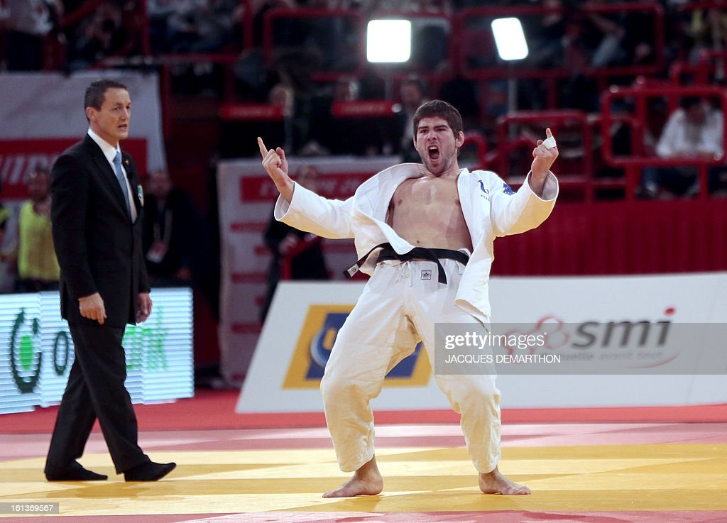 France's Cyrille Maret celebrates after winning the Bronze medal of the Men -100kg contest of the Paris' Judo Grand Slam tournament on february 10, 2013 in Paris.