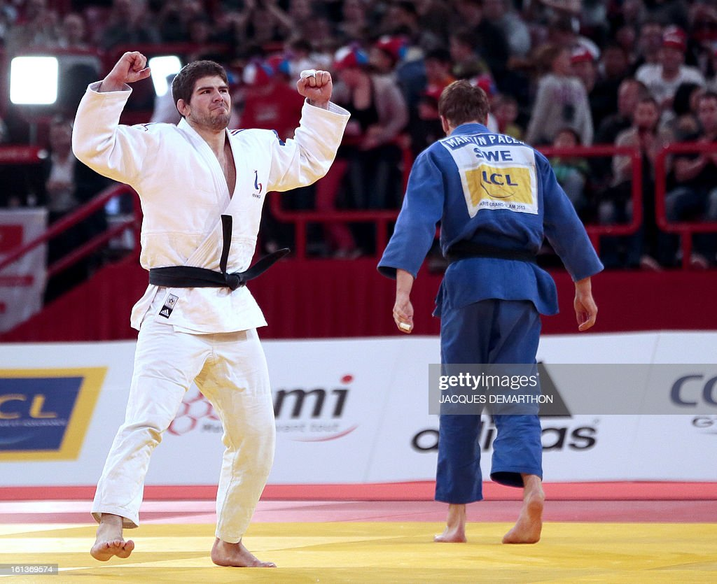 France's Cyrille Maret (L) celebrates after winning the Bronze medal of the Men -100kg contest against Sweden's Martin Pacek, at the Paris' Judo Grand Slam tournament on february 10, 2013 in Paris. AFP PHOTO / JACQUES DEMARTHON