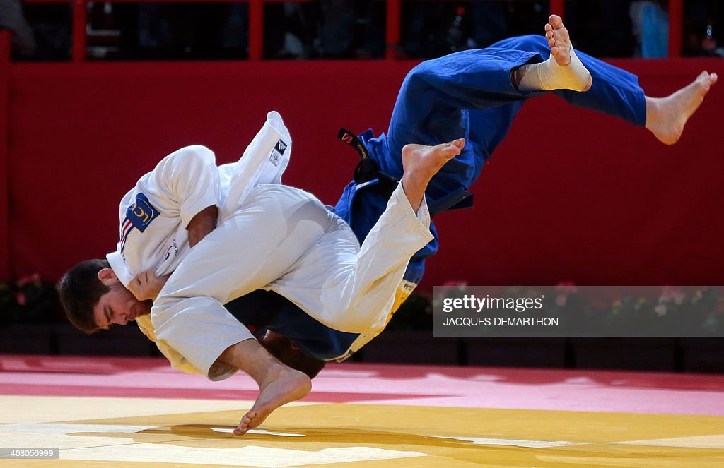 France's Cyrille Maret competes with Russia's Adlan Bisultanov during the men's 100kg quarterfinals at the 2014 Paris Judo Grand Slam tournament on...