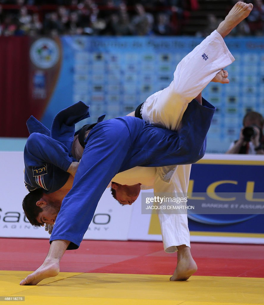 France's Cyrille Maret throws Czech Republic's Lukas Krpalek for the win in the final fight of the men's 100kg final at the 2014 Paris Judo Grand...