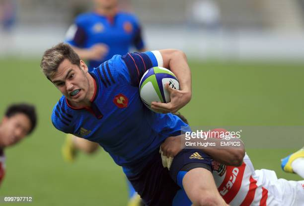 France's Damian Penaud dives over the try line to score his sides second try during the Under 20's Rugby Union World Cup match at the AJ Bell Stadium...