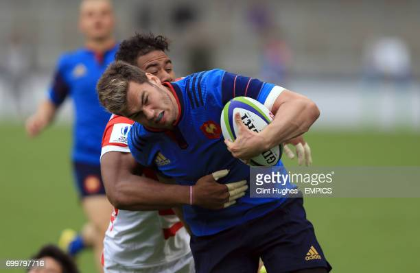 France's Damian Penaud drives through a tackle to score his sides second try during the Under 20's Rugby Union World Cup match at the AJ Bell Stadium...