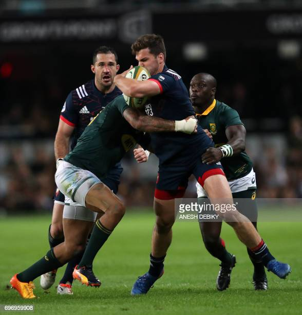 France's Damian Penaud holds the ball during the International test match between South Africa and France at the Kingspark rugby stadium on June 17...