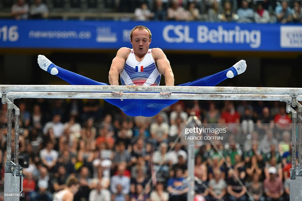 France's Danny Pinheiro Rodrigues performs during the Mens Parallel Bars competition of the European Artistic Gymnastics Championships 2016 in Bern, Switzerland on May 28, 2016. / AFP / FABRICE