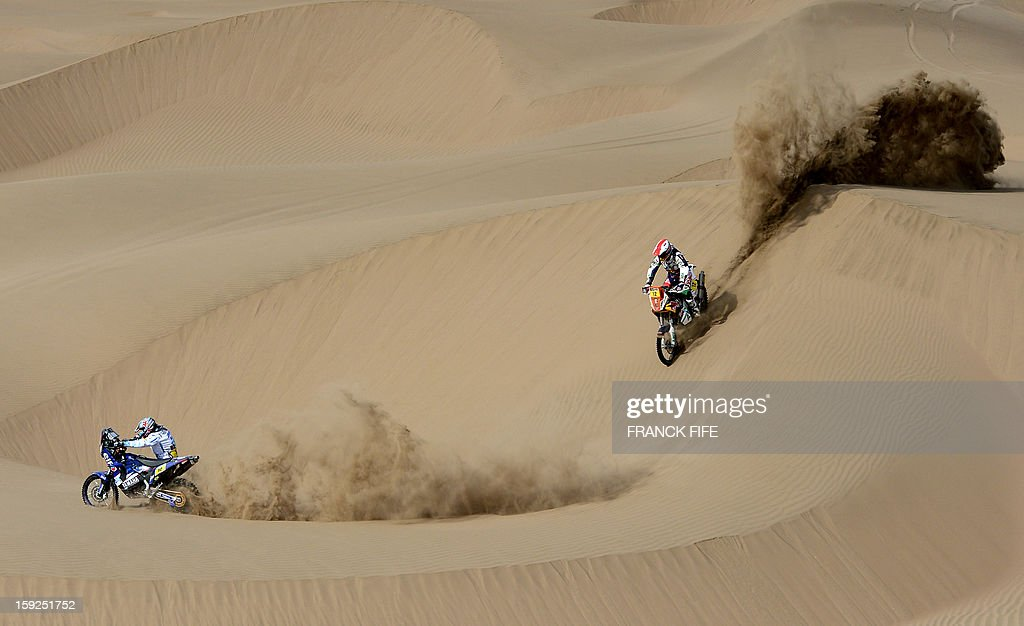 France's David Casteu (L) and Spain's Juan Garcia Pedrero compete during the Dakar 2013 Stage 6 between Arica and Calama, Chile, on January 10, 2013. The rally is taking place in Peru, Argentina and Chile from January 5 to 20. AFP PHOTO / FRANCK FIFE