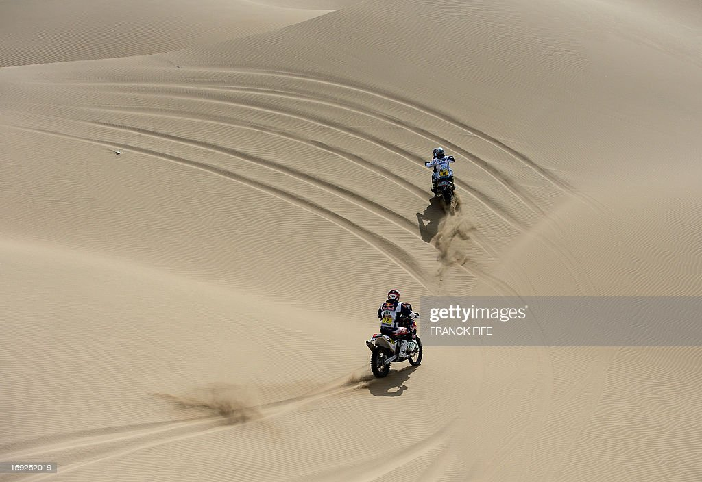 France's David Casteu (L) and Spain's Juan Garcia Pedrero compete in the Stage 6 of the 2013 Dakar Rally between Arica and Calama, Chile, on January 10, 2013. The rally is taking place in Peru, Argentina and Chile from January 5 to 20.