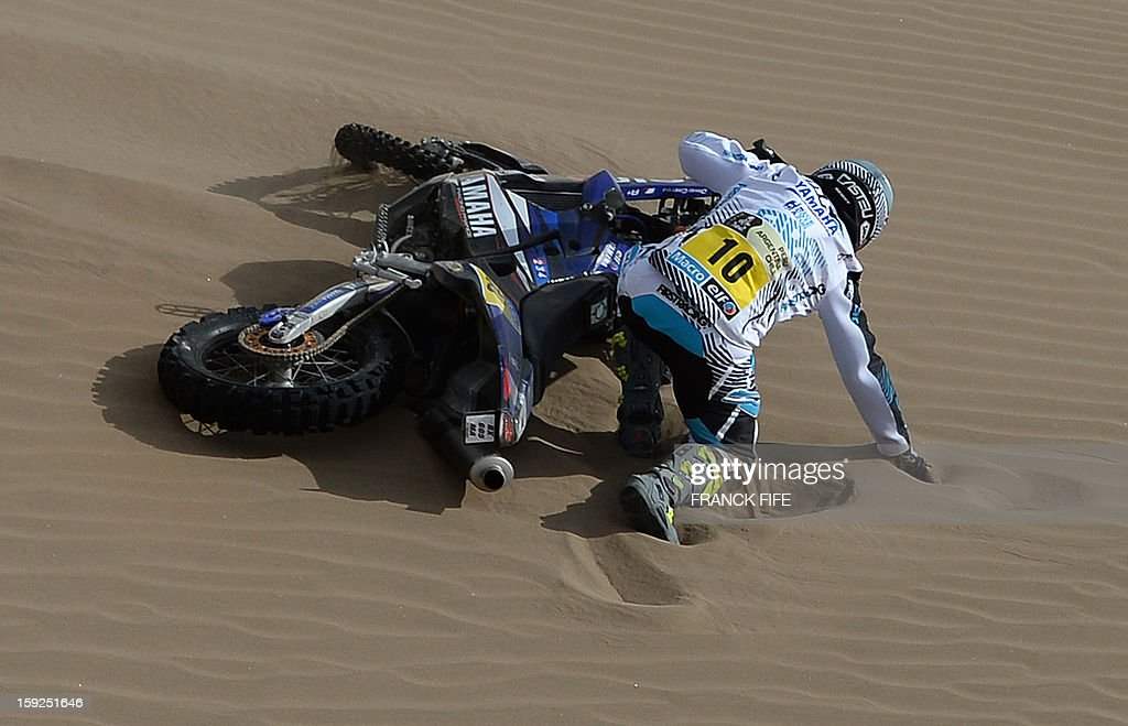 France's David Casteu falls during the Dakar 2013 Stage 6 between Arica and Calama, Chile, on January 10, 2013. The rally is taking place in Peru, Argentina and Chile from January 5 to 20.