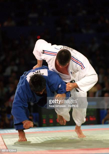 France's David Douillet in action against Japan's Shinichi Shinohara