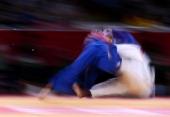 France's David Larose competes with Georgia's Lasha Shavdatuashvili during their men's 66kg contest match of the judo event at the London 2012...