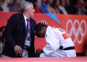 France's David Larose reacts after losing against Georgia's Lasha Shavdatuashvili during their men's 66kg contest match of the judo event at the...