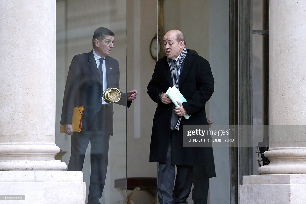France's Defence Minister Jean-Yves Le Drian speaks with French president's military chief of staff Benoit Puga as he leaves the Elysee presidential Palace on January 18, 2013 in Paris after attending a fifth Defence Council since French forces back the Malian army against Islamist rebels.