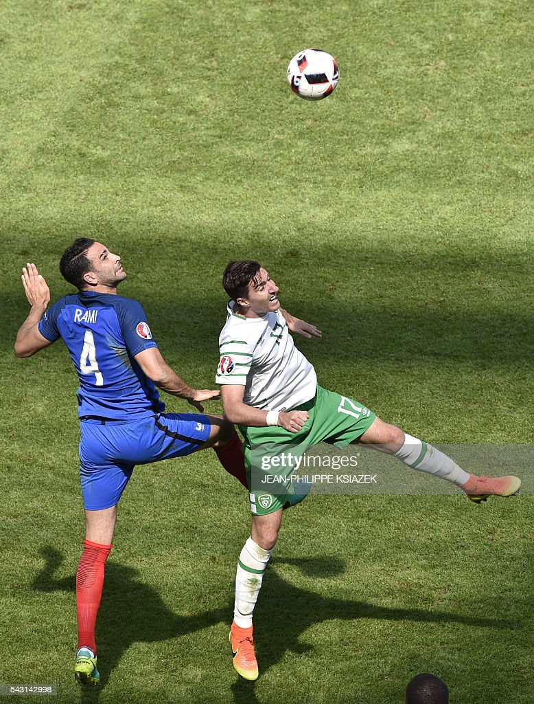 France's defender Adil Rami and Ireland's defender Stephen Ward vie for the ball during the Euro 2016 round of 16 football match between France and Republic of Ireland at the Parc Olympique Lyonnais stadium in Décines-Charpieu, near Lyon, on June 26, 2016. France won the match 2-1. / AFP / JEAN