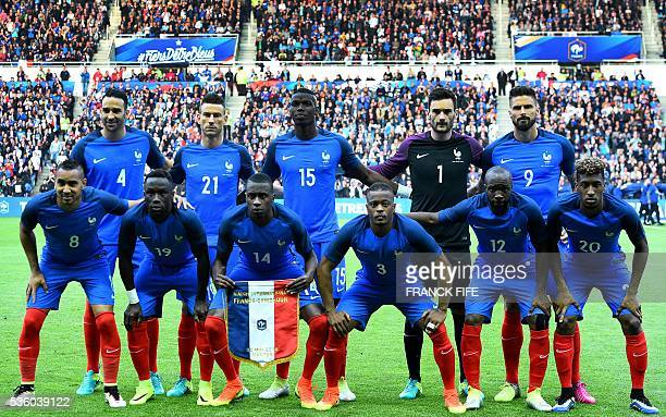 France's defender Adil Rami defender Laurent Koscielny midfielder Paul Pogba goalkeeper Hugo Lloris and forward Olivier Giroud France's forward...