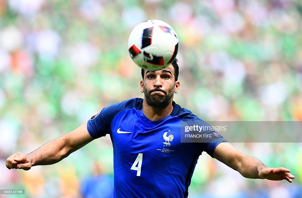 France's defender Adil Rami plays the ball during the Euro 2016 round of 16 football match between France and Republic of Ireland at the Parc Olympique Lyonnais stadium in Décines-Charpieu, near Lyon, on June 26, 2016. / AFP / FRANCK