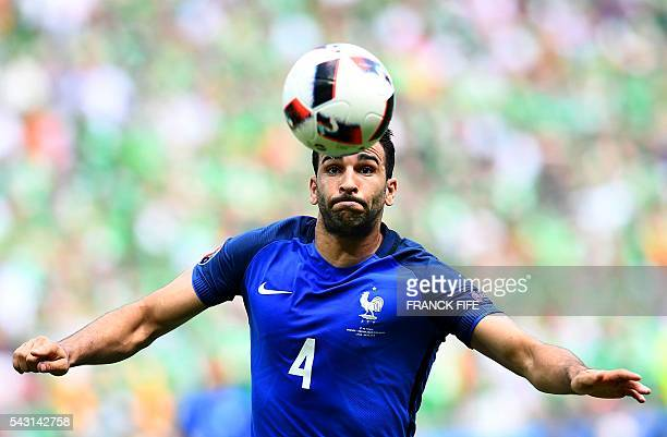 France's defender Adil Rami plays the ball during the Euro 2016 round of 16 football match between France and Republic of Ireland at the Parc...