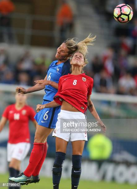 France's defender Amandine Henry and Norway's midfielder Andrine Hegerberg head the ball during the women's friendly football match between France...