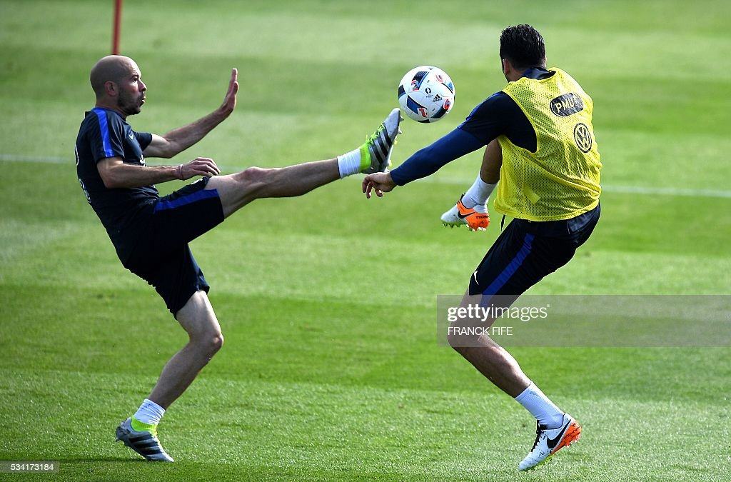 France's defender Christophe Jallet (L) vies with defender Adil Rami (R) during a training session in Clairefontaine as part of the team's preparation for the upcoming Euro 2016 European football championships, on May 25, 2016. / AFP / FRANCK