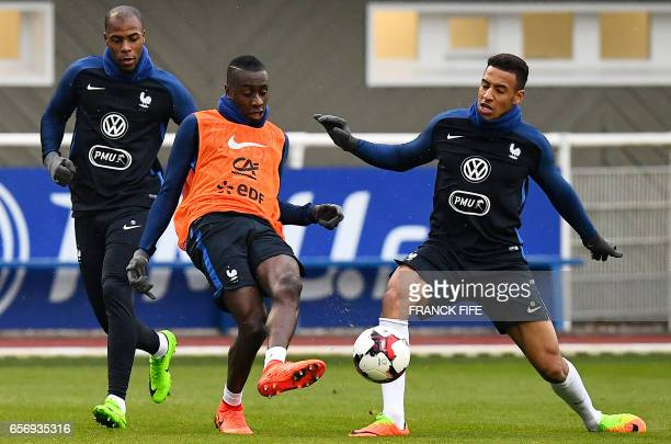 France's defender Djibril Sidibe France's midfielder Blaise Matuidi and France's midfielder Corentin Tolisso take part in a training session in...