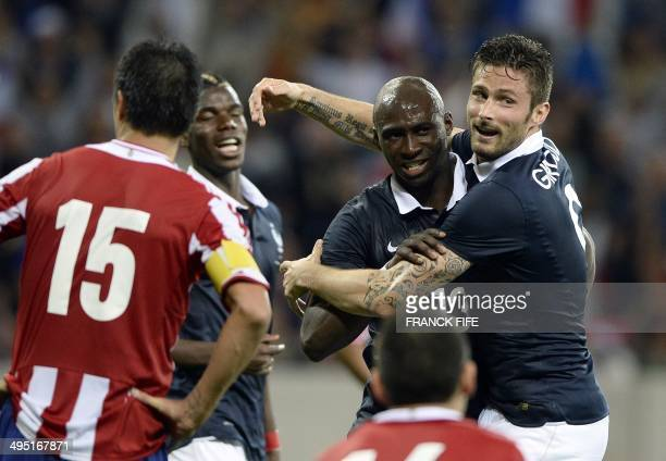 France's defender Eliaquim Mangala and France's forward Olivier Giroud celebrate after their team scored a goal during the friendly football match...