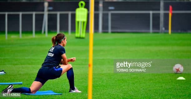 France's defender Jessica Houara d'Hommeaux stretches during a training within the UEFA Women's Euro 2017 football tournament in Zwijndrecht on July...