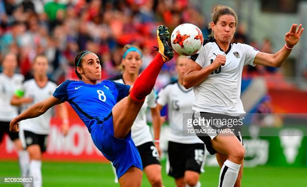 France's defender Jessica Houara d'Hommeaux vies with Austria's forward Nina Burger during the UEFA Women's Euro 2017 football tournament between...